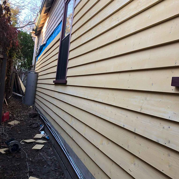 Weatherboards replaced on side of house St Kilda